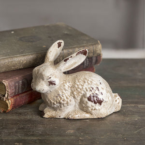 Our Antique White Cast Iron Bunny makes a sweet accent. This little sleeping bunny snuggles perfectly onto any shelf or tabletop. With its aged finish, it adds vintage charm to any room.