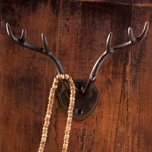 "This Antler Hook, with an antiqued dark metal finish, isn't just for the hunter in your family.  A fresh twist on rustic cabin decor, this antler hook makes a great wall accent for any room and is perfect for hats, leashes and more. 6.75""L x 5""W x 3""H)"
