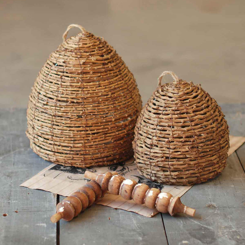 Bee Skeps are perfect for obtaining the look of an old English Country Garden. These small bee skeps also make a great addition to any tabletop or bookcase, as their handwoven quality lends a beautiful texture. Let these natural Bee Skeps make a charming addition to your farmhouse décor.