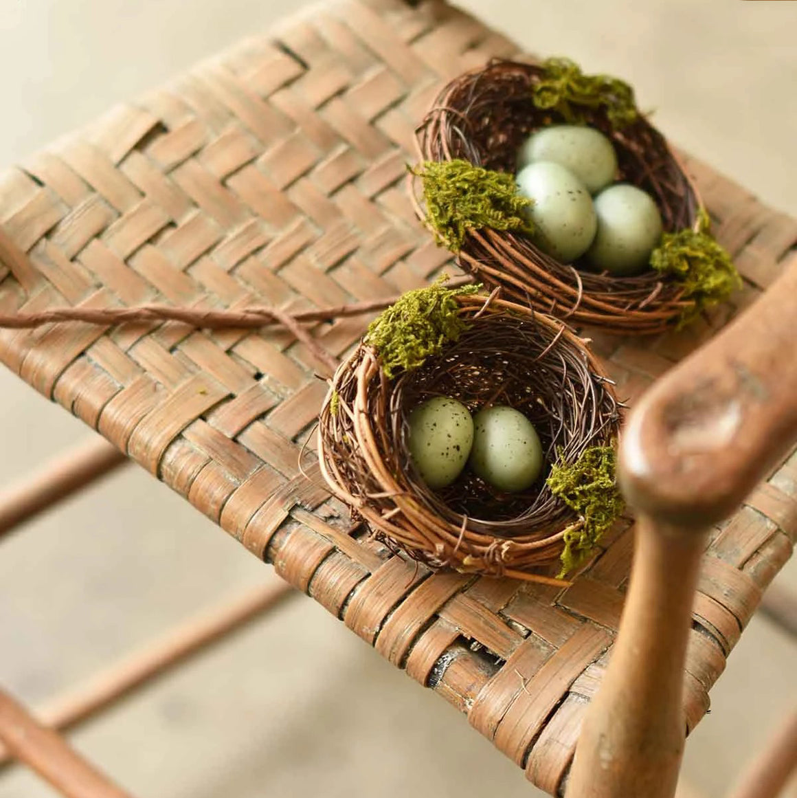 "Celebrate spring's natural wonder with this set of earthy and sweet Twig Nests with Eggs. The set of two features natural twig and moss construction, and each nest contains two or three spotted faux bird eggs. Gradual sizes with the largest nest being 4.5"" diameter. Set of two"
