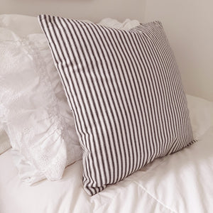 "Ticking stripe fabric has quintessential American farmhouse style. This sweet Black and Cream Ticking Stripe Pillow Cover is crafted of 100% cotton with button details on one side. This throw pillow is ideal for layering and lounging. Product dimensions: 18"" x 18"". Includes a Polyester insert."