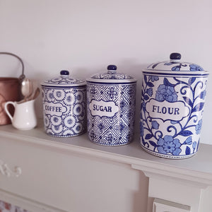 "An organized pantry, with staples like flour, sugar and coffee neatly stored away, is a must-have for farmhouse living. This beautiful set of three Blue and White Ceramic Canisters are inspired by vintage canisters with a French Country twist. They feature blue designs on white ceramic with Coffee, Sugar and Flour labels. Each has a rubber seal.  Coffee Canister: 5.75""Diam x 7.50""H with Lid, Sugar Canister: 5.75""Diam x 8.25""H with Lid, Flour Canister: 6.25""Diam x 9.75""H with Lid."