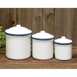 This set of three White Enamel Canisters with Blue Trim has nostalgic charm, reminiscent of grandma's kitchen. The set's retro style is perfect for farmhouse kitchens or bathrooms, and features distressed white enamel with blue trim. Canisters are food, oven and dishwasher safe.