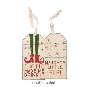 "A double-sided wooden bottle tag featuring distressed ""The Elf Made Me Drink It / Naughty Little Elf!"" sentiments with stocking, bell shoes, and star designs. Contains top fabric loop for attaching to a bottle of wine."