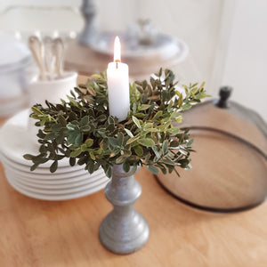 "No matter the season, our Boxwood Candle Ring brings a fresh, earthy style to your farmhouse decor. Perfect for adding a fresh twist to taper candle holders and chandeliers, this set of two will provide a charming decorative accent all year long. Set of Two. 5"" Diam with 2""inner"