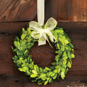 "Let this Preserved Boxwood Wreath with Ribbon add vibrant color to your country home decor. Crafted of real boxwood that's been specially preserved, this wreath will keep its fresh green color season after season. Use indoors. 6""Diam"