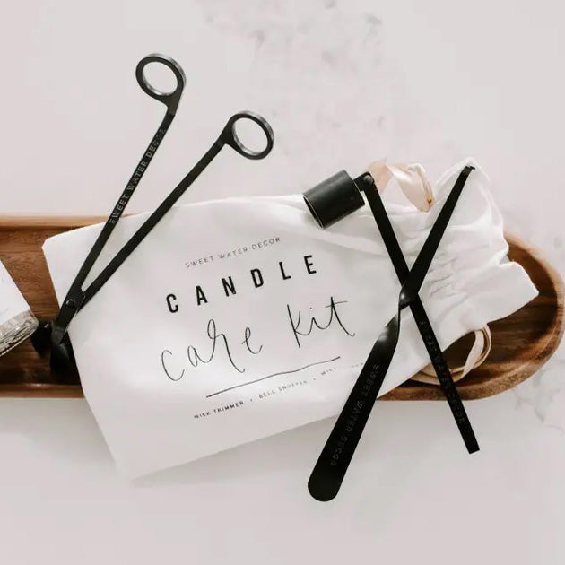 "Proper candle care is essential to the longevity of every candle. Ensure your candles have the best care with our Candle Care Kit, featuring wick scissors, wick dipper, and candle snuffer. Each kit arrives in a hand lettered bag for safe keeping.  KIT INFO:  Size: 9 x 5.3 x 1.25""  Color: Matte Black  Wick Trimmer: 6.75"", Candle Snuffer: 6.25"", Wick Dipper: 7.6""  Hand Lettered Drawstring Pouch Included"