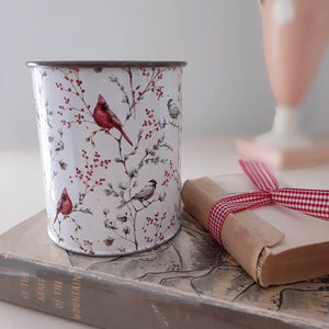 Our Cardinal and Berries Tin Pot is made of lightweight and durable metal and features a vintage style design of bright red cardinals and pip berries against a white background. This aged metal pot is ideal for displaying florals over the winter season or throughout the year. Place vibrant red pip berries and green foliage inside to bring out the warmth of the white finish.