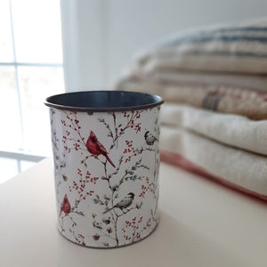 Our Cardinal and Berries Tin Pot is made of lightweight and durable metal and features a vintage style design of bright red cardinals and pip berries against a white background. This aged metal pot is ideal for displaying florals over the winter season or throughout the year.