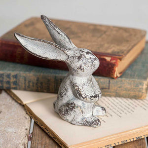 Our Cast Iron Long Eared Bunny makes a sweet accent. It's aged finish and adorable long ears make him the perfect addition to any shelf or tabletop. This little bunny brings charming whimsy to your spring and Easter décor. 4''W x 2''D x 5''H