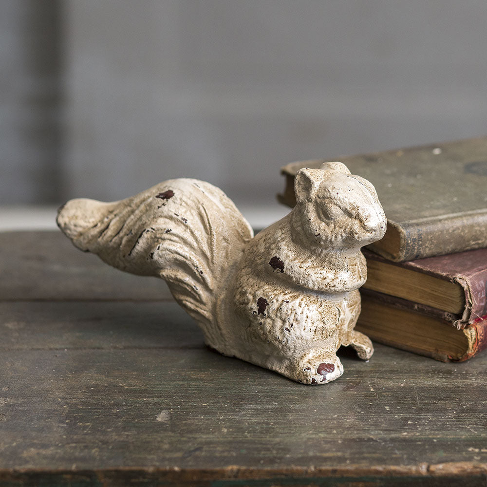 This sweet little Cast Iron Squirrel makes an adorable accent for a fall farmhouse. Let him squirrel away on any shelf or tabletop. With its aged finish, it adds vintage charm to any room.