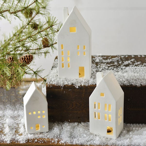 These white Ceramic Village Houses remind me so much of little coastal cottages found in villages tucked along the Maine coast. The set of three has a quiet elegance with an organic, minimalist design that epitomizes the Downeast style. Perfect for traditional or modern farmhouse decor. Make your village glow by adding flameless tea lights inside (not included).