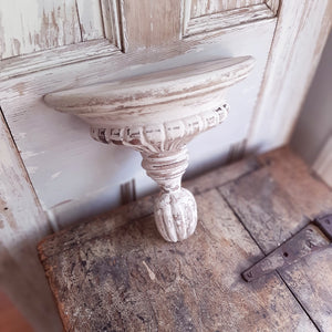 "Our Chippy White Corbel Shelf is an eye-catching piece that lends texture and vintage style to any room. Use an architectural element on a table display or create a beautiful wall display. The classic shell design and whitewashed wood give this accent dimension and charm. 11""L x 5.25""D x 9.75""H"
