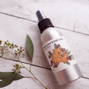This Citrus and Pine Linen and Room Spray is inspired by the memories of orange slices simmering on the stove with our fresh cut Christmas tree nearby. A warm and nostalgic scent, that is perfect all winter. Made pure essential oils. 4oz. Made in the USA