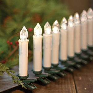 This set of 10 White Taper Candles with Clips is perfect for holiday decorating. Each taper features a dark green clip base for attaching to trees, wreaths, windowsills, garlands and more. Tapers have a warm white light and include a built-in timer that keeps them lit for 6 hours, then off for 18 hours. Clips also come with a handy remote for easy on/off functions from up to five feet away.