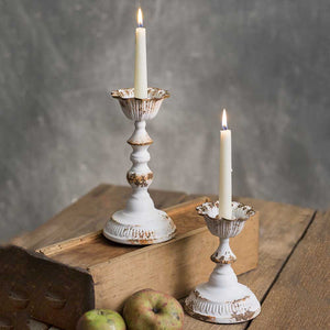 Our Collette Taper Candle Holder, set of two, feature romantic curves and an aged, rusted finish for that chippy white paint look that is familiar to today's vintage farmhouse style.