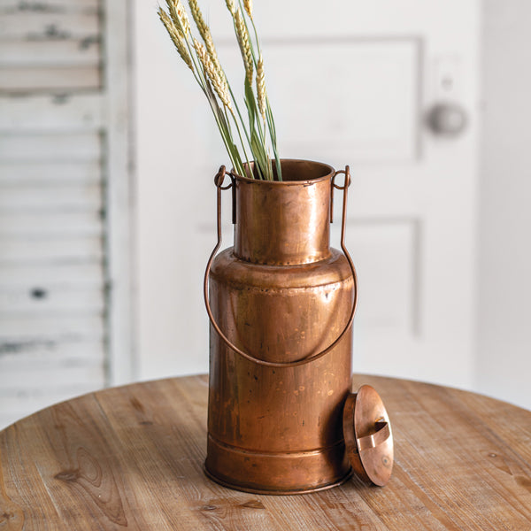 Bring old world charm to your farmhouse kitchen with these Copper Milk Can. Features a lid and handle for hanging. Perfect for bringing a bit of Downton Abbey flair to your farmhouse. 6'' dia x 13''H