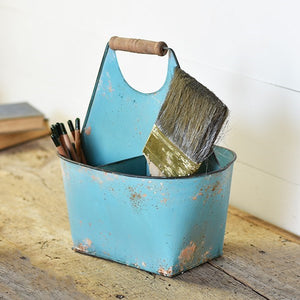 "This handy Cottage Blue Caddy is perfect for keeping small items neatly organized and at your fingertips. Features a distressed finish. The wood handle makes for easy transport. 10.6""L X 8.25""W X 11.75""H"