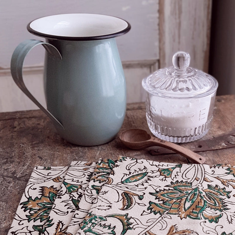 "Bring the easy charm of country cottage living to your farmhouse with our Country Green Enamel Pitcher with Black Rim. The simple allure of enamelware fits right in with any decor, but every farmhouse needs at least one piece. Inspired by flea market finds, our pistachio green enamel pitcher has black trim and makes the perfect vase for your favorite bouquet. Not food safe. Pitcher measures 6¼"" high by 5¼"" diameter (7"" wide with handle)."