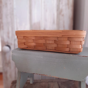 "Our Country Weave Basket, Long is infused with a Shaker style design. It's natural finish offers relaxed charm. There are countless uses for the country cutie: hold taper candles, utensils, napkins and more. It is a great little organizer basket for any room in your farmhouse. 10.75""L x 5.25""W x 3""H"