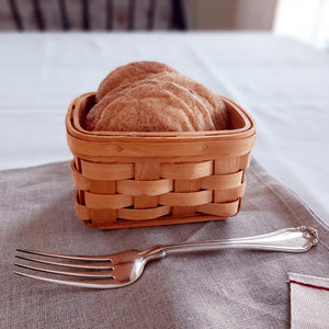 "Our Country Weave Basket, with its warm, natural finish can be used in so many different ways and in any room of your home. Use it to hold collectibles, eggs, shells, buttons, even business cards - there are just so many possibilities! It is a great little organizer basket. It is 2-1/2"" high by 5"" wide and 3-1/2"" deep."