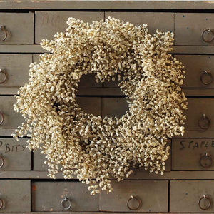 "Give a nod to late summer and fall with this adorable Cream Astilbe Wreath and Candle Ring. This faux astilbe wreath adds a sweet touch to any room. Hang from the back of a chair to create an elegant table for guests or use as a candle ring for large hurricane and candles.  12"" round 6.5"" inner"