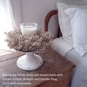 "Give a nod to creamy white with this adorable Cream Astilbe Wreath and Candle Ring. This faux astilbe wreath adds a sweet touch to any room. Hang from the back of a chair to create an elegant table for guests or use as a candle ring for large hurricane and candles.  12"" round 6.5"" inner"