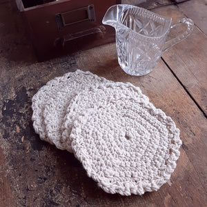 "Let these charming Vintage Style Crochet Coasters add antique flair to your farmhouse. The warm oatmeal color and thick crochet design lends a soft touch to any room. Set of four, each 5"" in Diam"