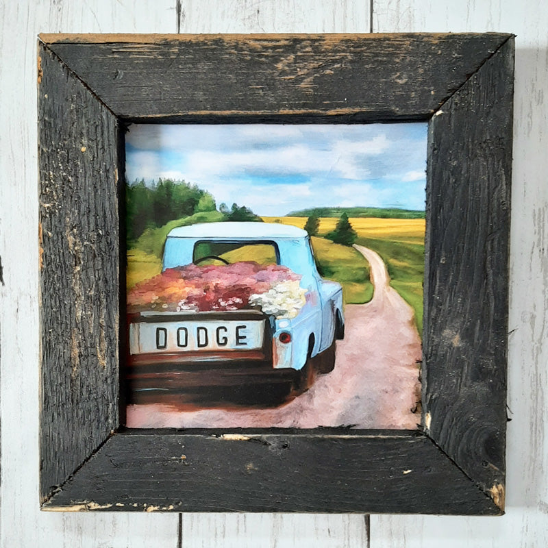 "There's nothing more cheerful than a truck full of flowers and a bright blue sky. This Dodge Flower Truck Wall Art is an iconic image that will make you smile. The aged black frame is made of barnwood reclaimed from centuries-old wood from upstate NY. The artwork is printed on high-quality matte paper with archival inks and mounted permanently to 1/8"" hardboard which is mounted to the frame.Made in the USA ."