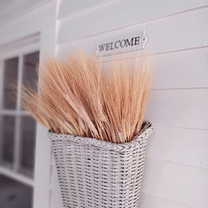 "Celebrate the warmth of the harvest season with this Decorative Dried Wheat Bundle. Wheat Bundles are tied with natural twine to bring nature's beauty to your country style decor. Symbolic of a bountiful harvest, these heavy-headed wheat stalks make an elegant statement. Approximately 20"" tall"