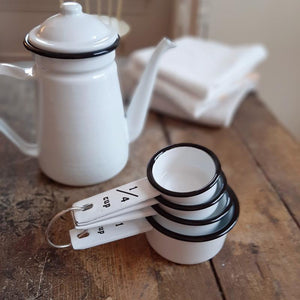 Not only useful, but our White Enamelware Measuring Cups, Set of Four, has a ton of charm to add to your farmhouse kitchen. The vintage style white enamelware cups, with black rims, nests together neatly, and they will surely inspire you to cook up something new. Makes a great gift for those who love to cook and bake. Set of four: 1 cup, 1/2 cup, 1/3 cup, 1/4 cup