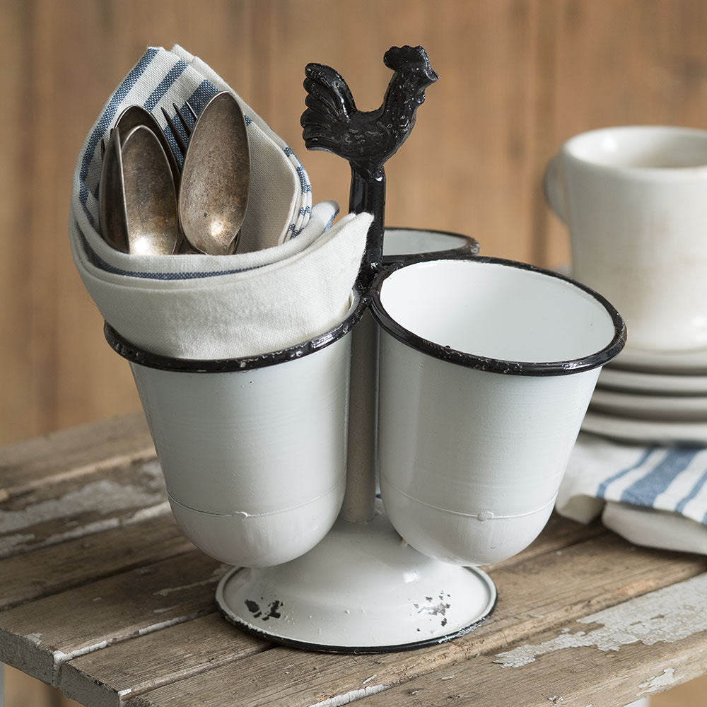 "Make farmhouse style entertaining indoors or out a bit easier with this Enamel Style Utensil Caddy. Made of metal, this caddy has three cups that are 4"" in diameter and 4½"" tall."