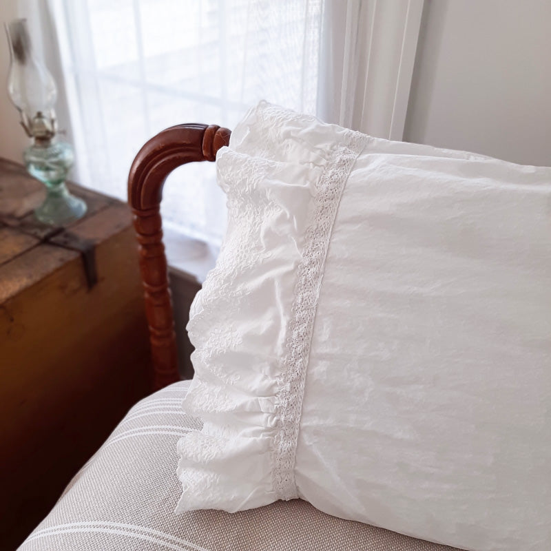 Our Eyelet and Ruffles Pillow Sham brings shabby chic and farmhouse style together to create a dreamy white cottage bedroom. This Sham features a double layer of snow-white ruffle edges with exquisite floral eyelet detail and embroidered trim on both ends. This lace edge sham will add texture and a charming vintage look to your room.
