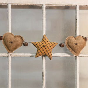 "Create an old-time rustic window display or mantle treatment with our Primitive Fabric Heart Garland. This sweet garland features three stuffed fabric stars and two stuffed burlap hearts assembled on a black string. Each heart and star is accented with a ⅓"" rusty jingle bell, and a 1″ jingle bell hangs between each one. Hearts and stars measure 5-6″ wide. Garland measures 4 foot long."