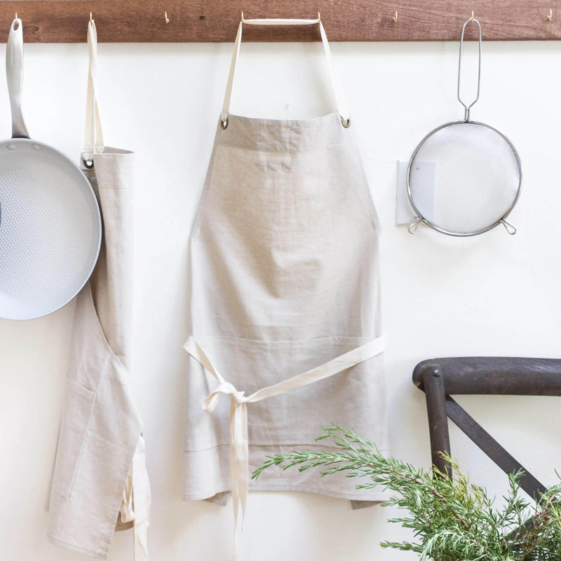 Whether you're cooking up a storm in your farmhouse kitchen, cleaning or grilling with the neighbors, you can protect your wardrobe with this handsome, practical Farmhouse Apron. It has a handy pocket and adjustable straps. One Size Fits All.