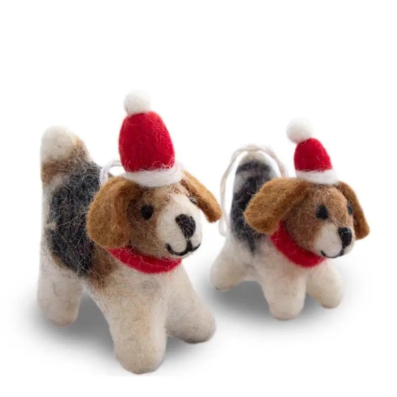 "These Felted Wool Dog Ornaments are hand-made by shaping organic wool with soap, water, and hand pressure. They feature delicately hand-sewn details, from their little eyes and ears to their wagging tails, give these little Santa's Helpers their unique character and beauty. Comes in a set of 2, one puppy one adult, packaged in a hand-made reusable lokta paper bag. Set of two. Measuring approximately 3.5""x3.5"" the adult and 2""x2"" the puppy. Not intended for children."