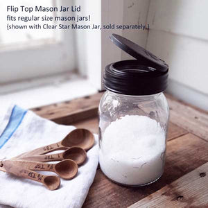 Flip Top Mason Jar Lid is ideal for on-the-go meals and home organization. This Flip Top Mason Jar Lid screws onto regular mouth Mason jars and flips to a large 2 inch opening. Store oats, fruit, salads, and more. Made in the USA