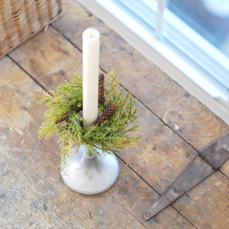 "Our Forest Pine Candle Ring brings fresh, earthy greenery to your farmhouse decor. Perfect for adding cabin style or a rustic twist to taper candle holders and chandeliers, this set of two will provide a charming decorative accent all year long. Set of Two. 6"" Diam with 2""inner"