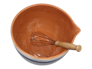 "The French Farmhouse Batter Bowl with Whisk will help you whip up a farmhouse style pancake breakfast and other goodies. This vintage style batter bowl is the perfect addition to any kitchen collection. Features a creamy white ceramic with blue stripes for old country farm kitchen style and a spout for easy pouring. Includes a whisk with a wooden handle. Hand-wash recommended. 8.5""Diam x 8""H"