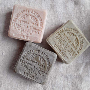 These authentic 100% natural and organic french soaps are made with pure olive oil. The set includes one lemon, one honey and one clay soaps. The delicate scents fill the air with fresh, clean aromas as you soothe and soften skin with nurturing olive oil. Each soap is stamped for added beauty. Fill a jar and create a beautiful accent for your bath. Set of three. Each 4.41oz