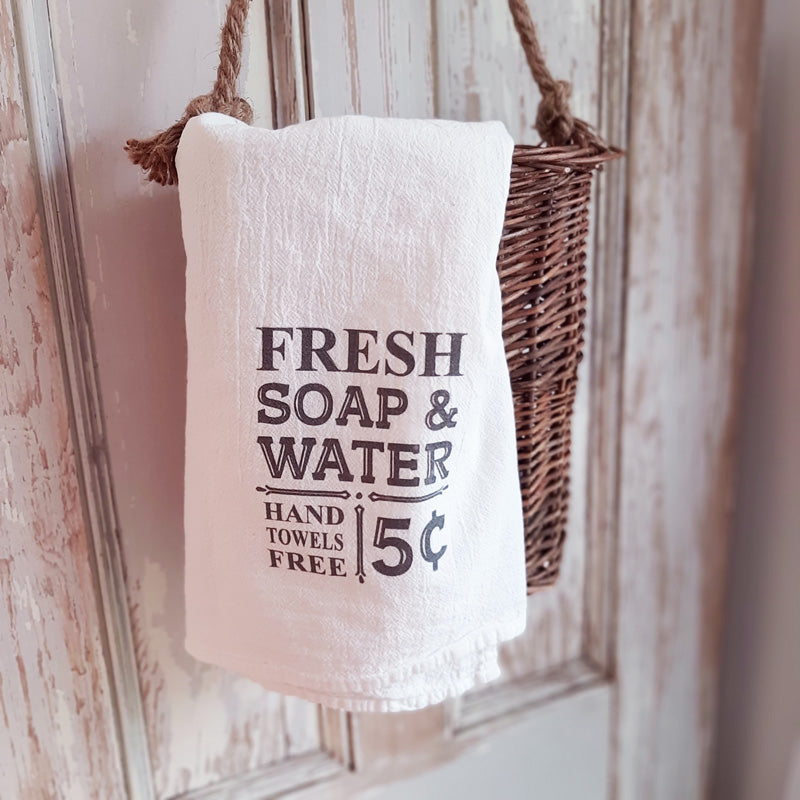 "The Fresh Soap and Water Flour Sack Towel adds the perfect vintage touch to any kitchen or bath. Made of absorbent 100% organic cotton, this flour sack style towel has hemmed edges. Printed with permanent, water-based inks. Machine washable, dryer safe. Measurement when unfolded is 25"" square. Made in the USA"
