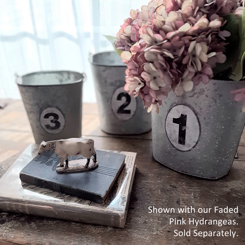 There are many great uses for our Galvanized Numbered Pails. Organize utensils and napkins for rustic style entertaining or pack with your favorite flowers. Each galvanized oval-shaped pail includes a vintage style number tag, and a turned wood handle. They nest together for easy storage. Set of three.