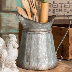 Add rural and rustic style to any room in your farmhouse with our Galvanized Milk Pitcher. Inspired by antique shop finds, this pitcher is generous in its size and has a wide mouth, so it can be packed with your favorite flowers or baking utensils.