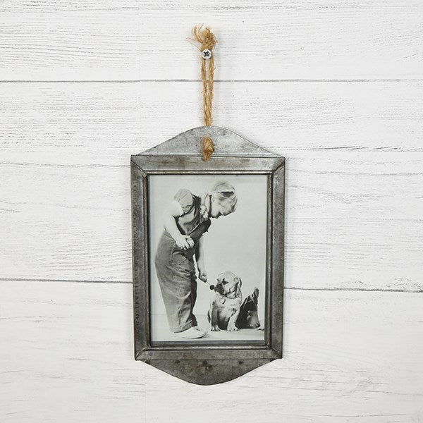 "Create a magical photo wall by adding several of our Galvanized Tin Frames together. The simple, rustic and down-to-earth style of this galvanized tin frame is a perfect match for farmhouse decor. Holds a 4 x 6 photo and comes with twine for hanging. 5.1""L X  9.25""H"