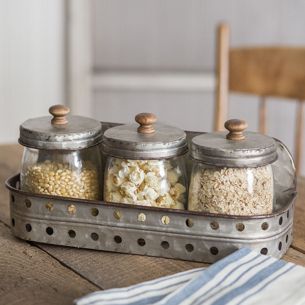Give your kitchen or bath the vintage storage that matches your farmhouse style. Store cotton-swabs and soaps or paper clips and rubber bands in these handy glass canisters with metal lids and rustic wood knobs.