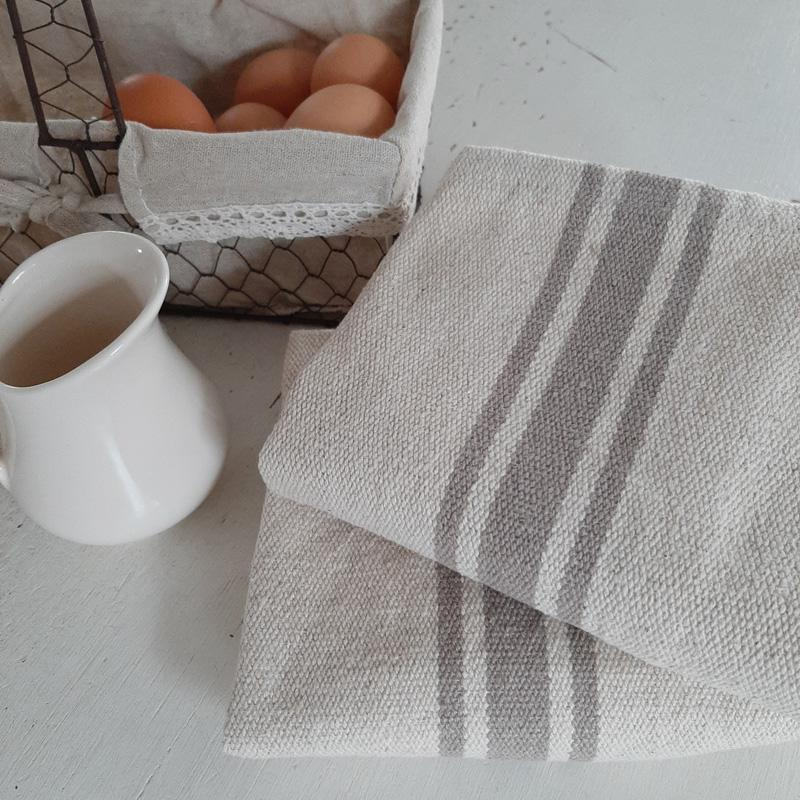 Our Grain Sack Dish Towels with Grey Stripes offer relaxed elegance, perfect for everyday farmhouse living. With plenty of French country charm, these dish towels have the look of well-worn feed sack material. The warm oatmeal color and grey stripes give them pure farmhouse charm. Easy to care for, they get softer with each washing. Vintage style farmhouse decor never looked so appealing.