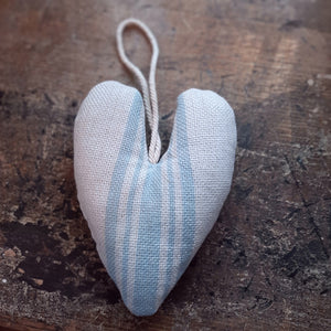 "This sweet heart lavender sachet adds instant charm to any room in your farmhouse. The Grain Sack Lavender Heart with Blue Stripe is woven with 100% cotton and filled with lavender. Cotton cording allows for use in the nursery on a hook, door knob or inside the dresser for extra sweetness. 5"" x 6"""