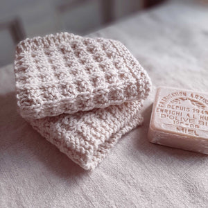 "This super soft vintage style Hand-Knit Waffle Washcloth adds a bit luxury to your bathing experience. Handmade of 100% Certified Organic Cotton, this knit washcloth, with its waffle weave pattern, is designed for scrubbing without damaging the skin. It promotes circulation and gentle exfoliation. Machine wash/dry. Set of two. 8.5""L x 8""W"