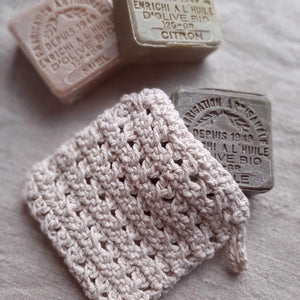 "This super soft vintage style Hand-Knit Soap Sock adds a bit luxury to your bathing experience. Handmade of 100% Certified Organic Cotton, this knit soap bag fits a bar soap and creates a rich lather as you wash. Designed for scrubbing without damaging the skin. It promotes circulation and gentle exfoliation. Machine wash/dry. 5""L x 4.5""W x 0.25""H"