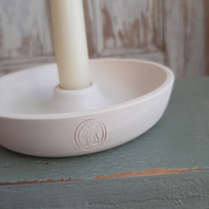 "This Hand-Thrown White Stoneware Taper Candle Holder, with its quiet elegance and clean design, will quickly become a treasured heirloom. Made in Pine Lake, Georgia by artisans that honor handmade traditions, this piece is equal parts modern simplicity and organic imperfection. The white satin finish and hand-stamp add to its rustic charm. Fits standard 3/4"" taper candle - Approx. 5.75"" x 1.5""  Made in the USA"